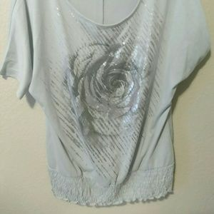Woman's metallic rose print shirt